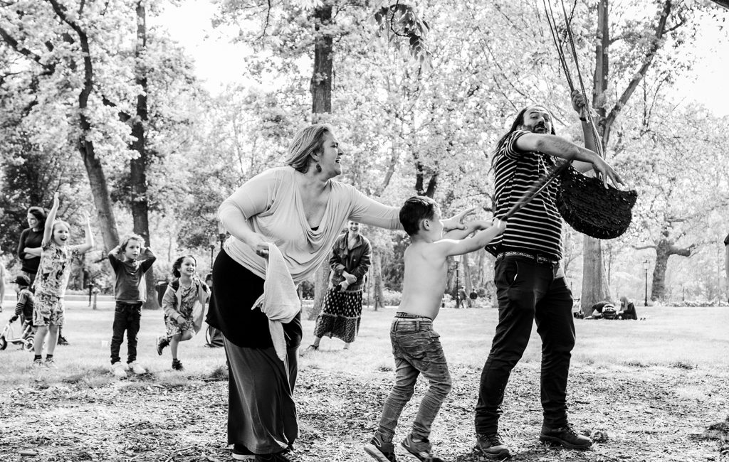 Piñata moment in a birthday party in Amsterdam. Documentary photographer of family events.